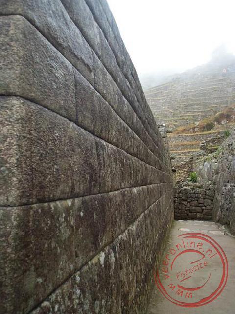De perfecte gebouwde tempelmuren in Machu Picchu