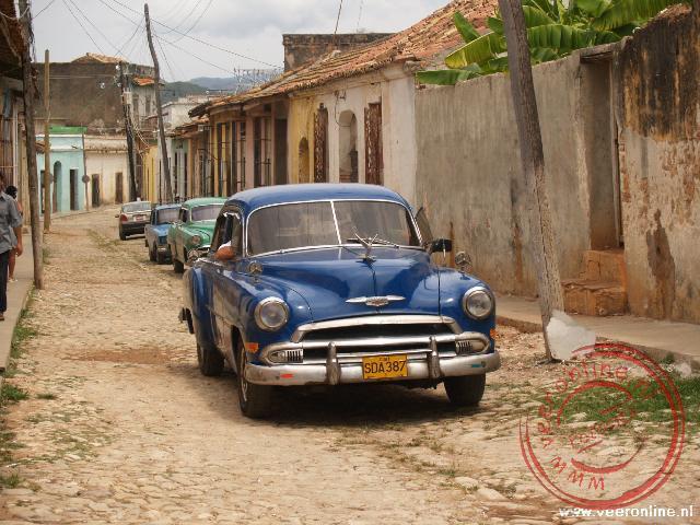 De oldtimers passen goed in het straatbeeld van Trinidad