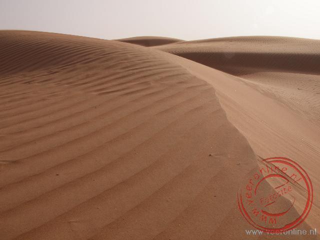 De zandduinen van de Wahiba Sands in Oman