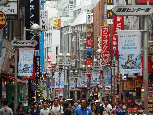 De drukte in de straten in de wijk Shibuya